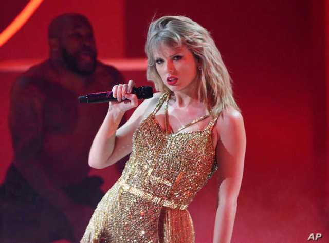 FILE - This Nov. 24, 2019 file photo shows Taylor Swift performing at the American Music Awards in Los Angeles. A documentary…