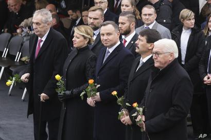 From right, the presidents of Germany Frank-Walter Steinmeier, Hungary Janos Ader, Poland Andrzej Duda, Slovakia Zuzana Caputova and of the Czech Republic Milos Zeman, are seen at Berlin Wall ceremony, in Berlin, Germany, Nov. 9, 2019.