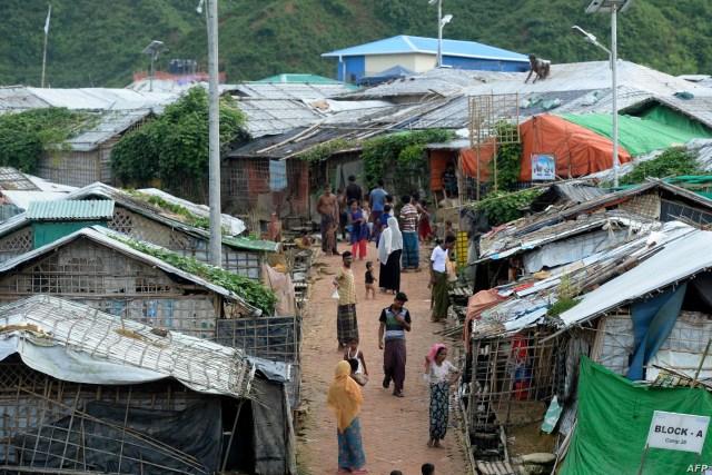 Rohingya people are seen at a camp in Teknaf on August 21, 2019. / AFP / MUNIR UZ ZAMAN