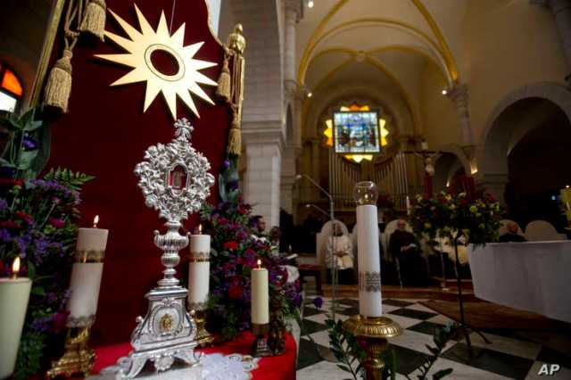 A wooden relic believed to be from Jesus' manger is seen in the Church of the Nativity, traditionally believed by Christians to…