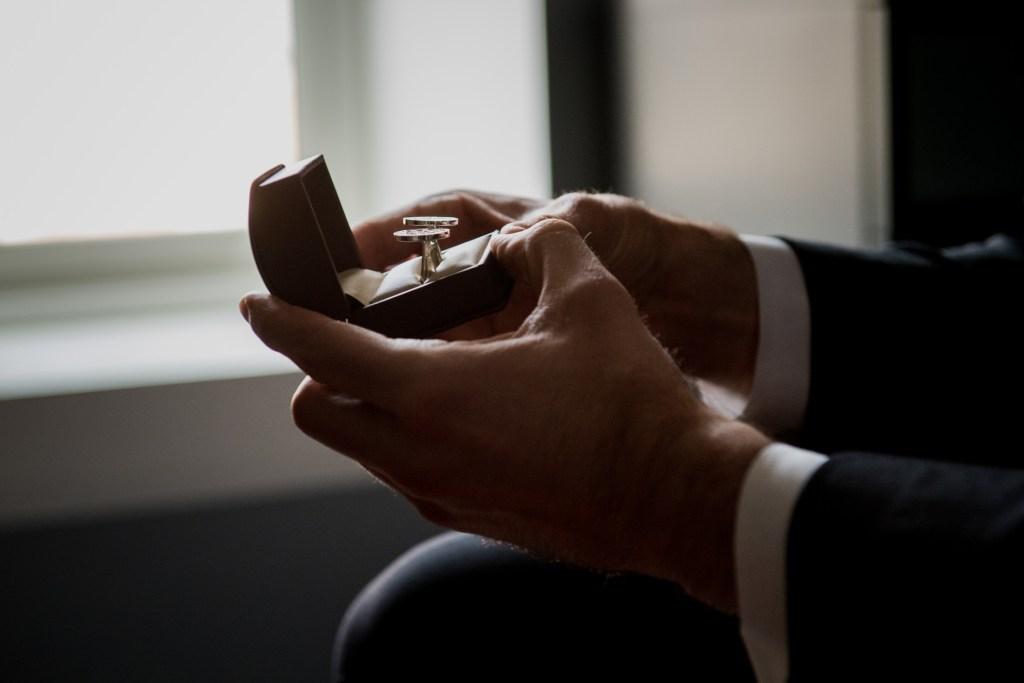 groom holding rings for Columbus Ohio Westin Wedding