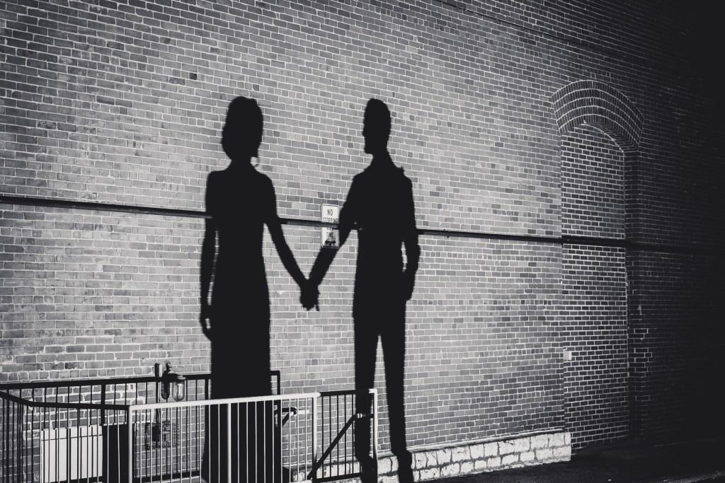 Couple holding hands shadow at columbus ohio westin wedding