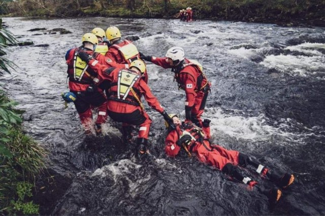 Water training taking place with recruits pulling a person to safety