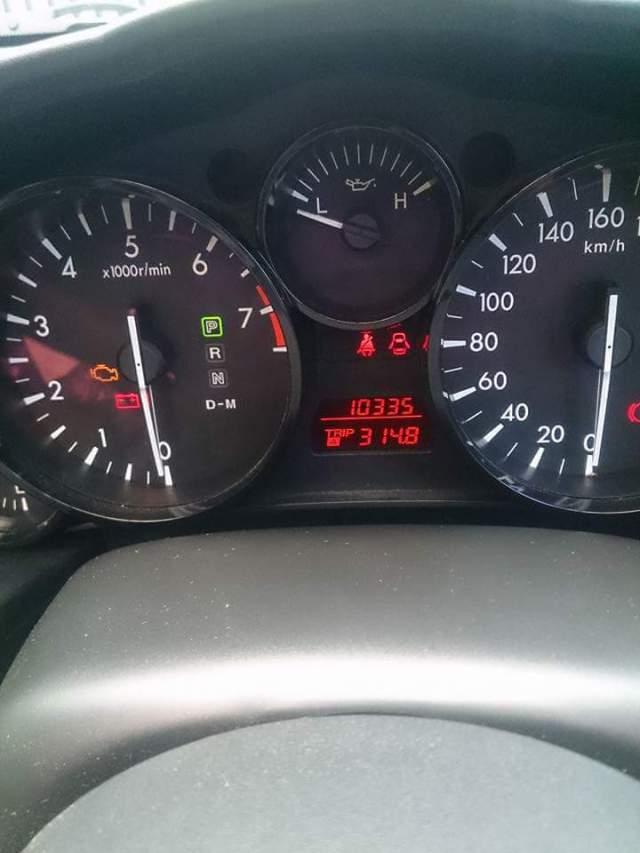 cara tahu letak tutup tangki bbm di mobil berdasarkan indikator bbm~01