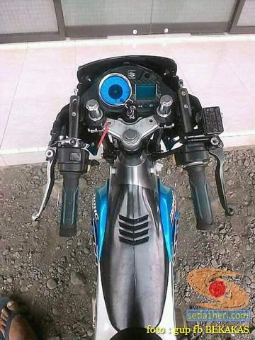 Apa kelebihan dan kekurangan model stang jepit lurus angka 11 kayak gerobak bakso pada sepeda motor ?...hehehe