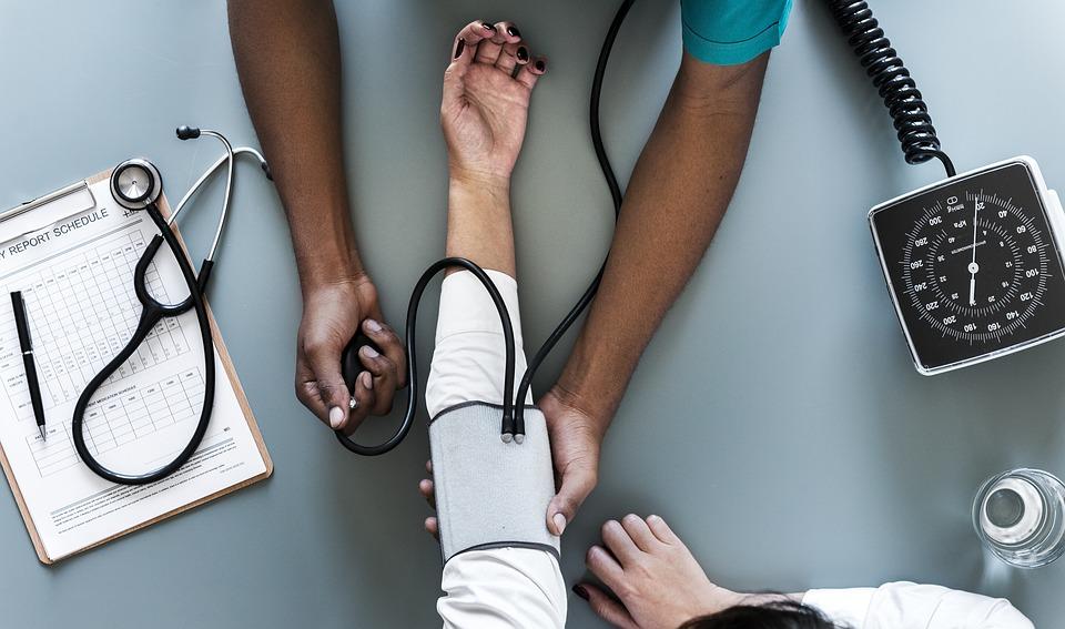 nurse-checking-blood-pressure