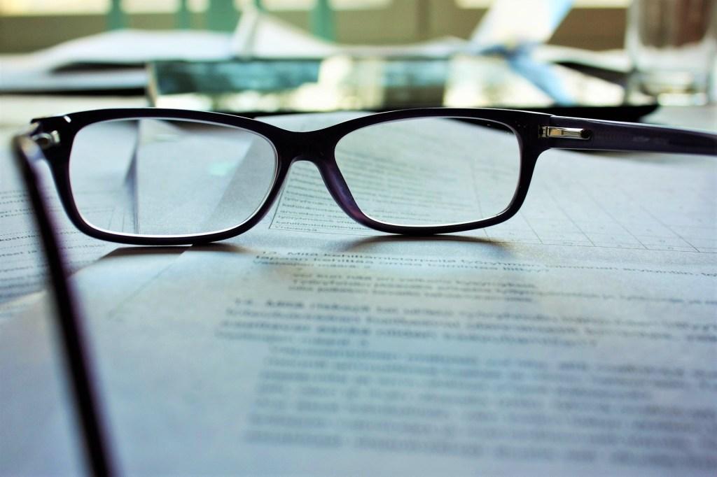 eye-glasses-on-desk