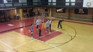 Students participate in an intramural quidditch match in the gym. Photo courtesy of SHU Intramural's & Campus Recreation Facebook Page