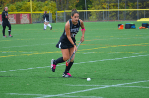 Junior midfielder, Taylor Dohar, running the field. Photo courtesy of D.Clark/Setonian