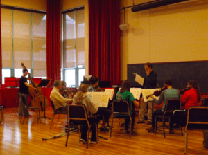 Members of the community and students alike practice for their upcoming concert. Photo courtesy of H.Carnahan/Setonian