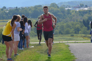 Sophomore Peter Swain from Butler, Pa. leads the way in a race. Photo courtesy of D.Clark/Setonian