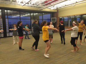 SMAC attendees warm up to learn new self-defense moves.