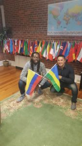Katarebe and Henao hold flags from their countries. Photo courtesy of C.Arida.