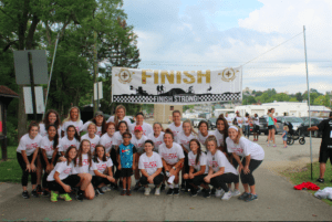The group poses for a picture by the finish line during the Quigley 5K event. Photo courtesy of D.Clark.