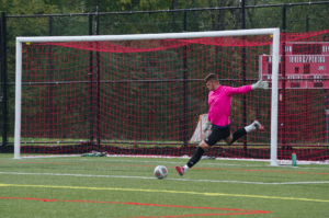 Freshman goalkeeper Austin Iddon from Jeannette, Pa. winds up for the kick. Iddon is a local student-athlete who previously attended Penn Trafford High School. He currently has 53 total saves in 16 games played for the Griffins. Photo courtesy of J.Palmer/Setonian.