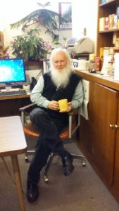Black poses with a cup of tea in hand. He keeps a log of everything that has been asked about and looked at, which will also be archived. Photo courtesy of L.Cowan/Setonian.