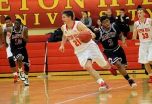 Davis, who was named last week's Dino's Athlete of the Week, dribbles up the court. Hard work has expanded his talents to be able to do so. #21's favorite sports team is the defending National Champions of the NBA, the Cleveland Cavaliers, and his favorite player is Kevin Love. Photo courtesy of D.Clark/Setonian.