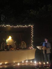 Faith Dent reads a passage from the Book of Isaiah before Jesus is placed in the crib.