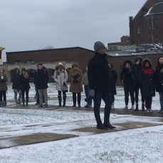 Elise Michaux, SHU's director of student involvement, stands with participants at the end of the walkout on March 14. Photo by L.Cowan/Setonian.