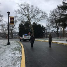 SHU campus police escorted participants as they walked around campus on March 14. Photo by L.Cowan/Setonian.