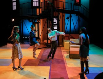 """Robert (Noah Telford) is thrown around during """"You Could Drive a Person Crazy"""" in Seton Hill University's production of """"Company"""" by his love interests: Kathy (Hannah Taylor, left), April (Nicole Castelli, second from left) and Marta (Azaria Oglesby, right)."""