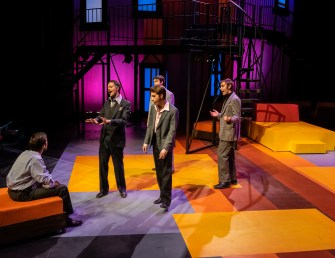 """Robert (Noah Telford) sits and listens to his friends Larry (James Scharer), Peter (Cameron Nickel), David (Travis Miller) and Harry (Lance Joos) sing """"Have I Got A Girl for You"""" during Seton Hill University's production of """"Company"""" from Oct. 19-27."""