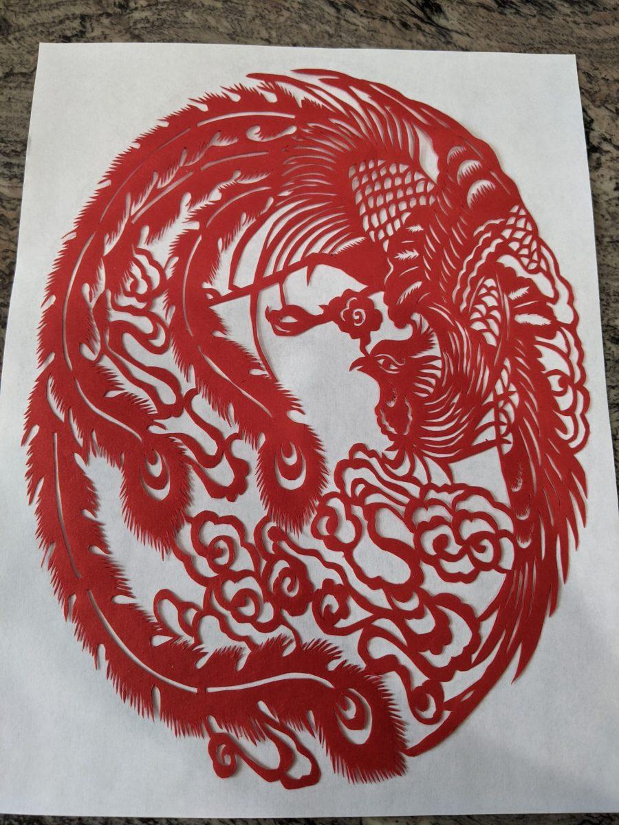 Cut paper phoenix in red
