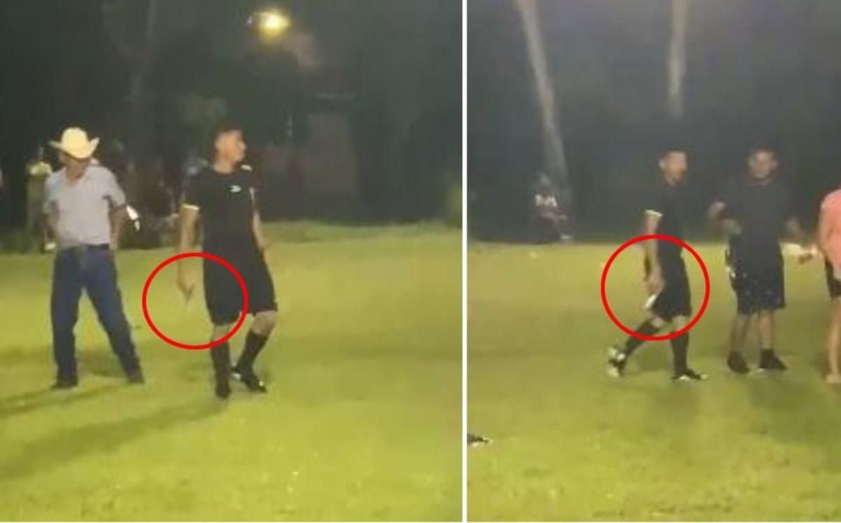 #Viral Árbitro saca pistola durante partido para defenderse de los jugadores y aficionados