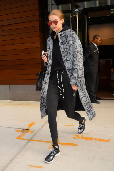 These sweats look runway ready thanks to Gigi'sreflective shades and fashion-y coat.