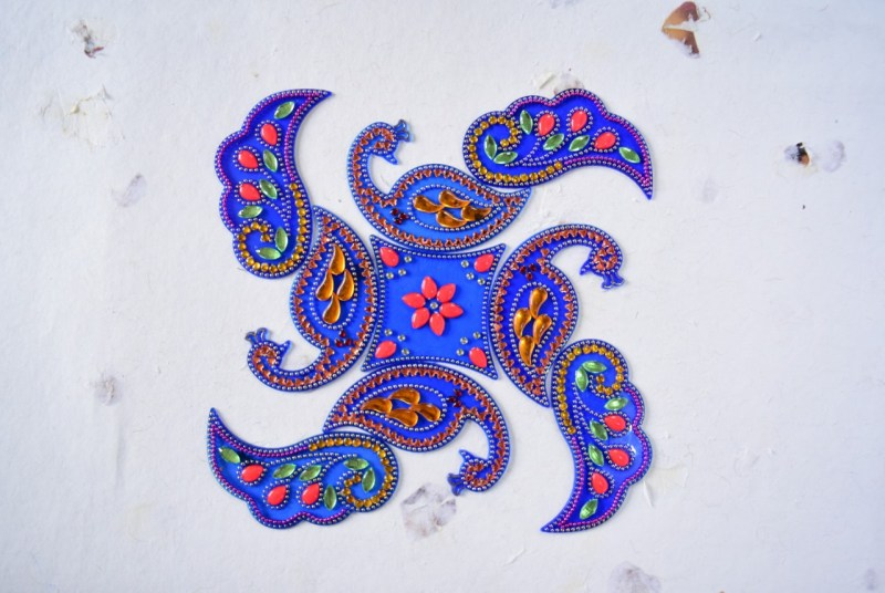 acrylic rangolis for wedding decoration - peacock theme