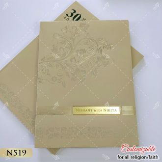 golden padded card with acrylic logo