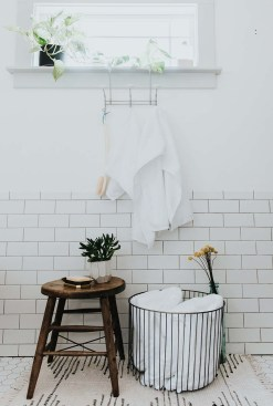 Sevenfold's Egret White Lotus Loop Towels hanging in a bathroom, under a window.