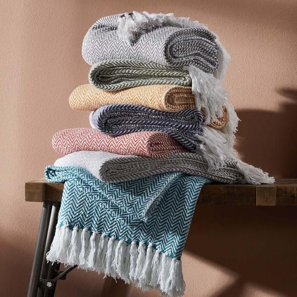 Stacked Chevron Throws with seasonal colors shown