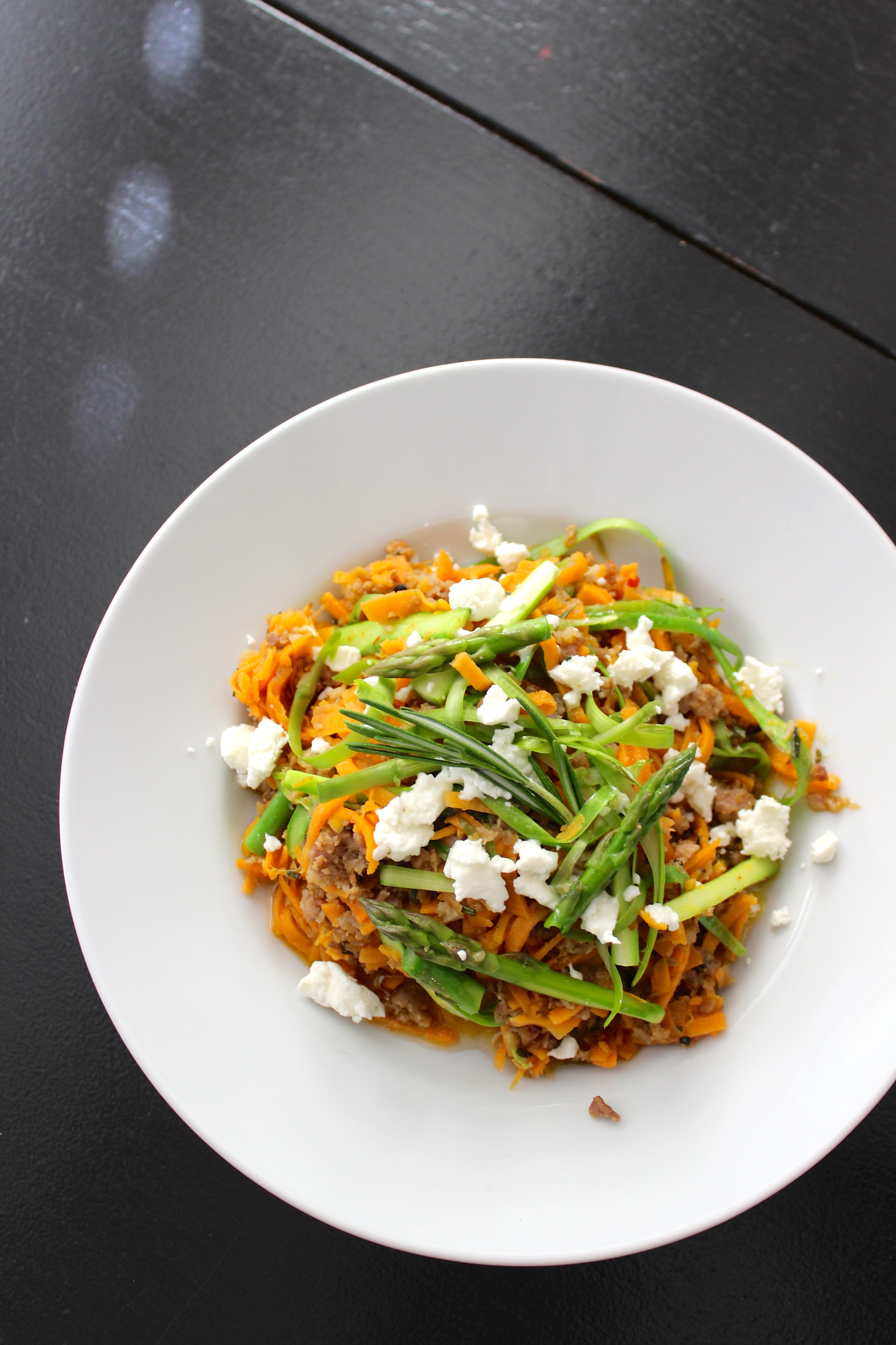 "sweet potato ""pasta"" with sausage, rosemary, shaved asparagus, and goat cheese; vegetable noodles; spiralizer recipe"