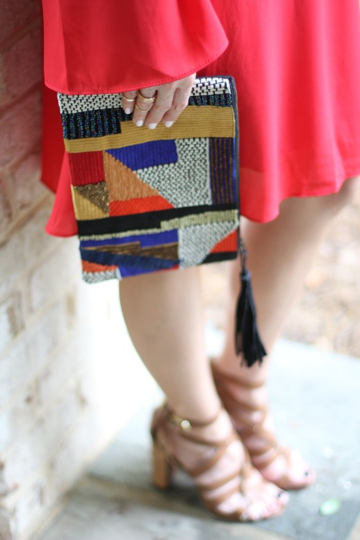 maternity outfit; red maternity dress; embroidered clutch