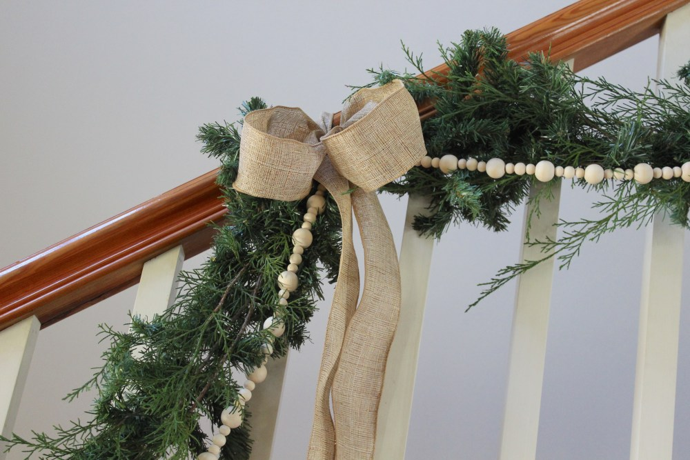garland on stairs with DIY wood bead garland