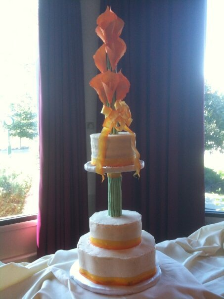 Multi level wedding cake with gumpaste calla Lilly.