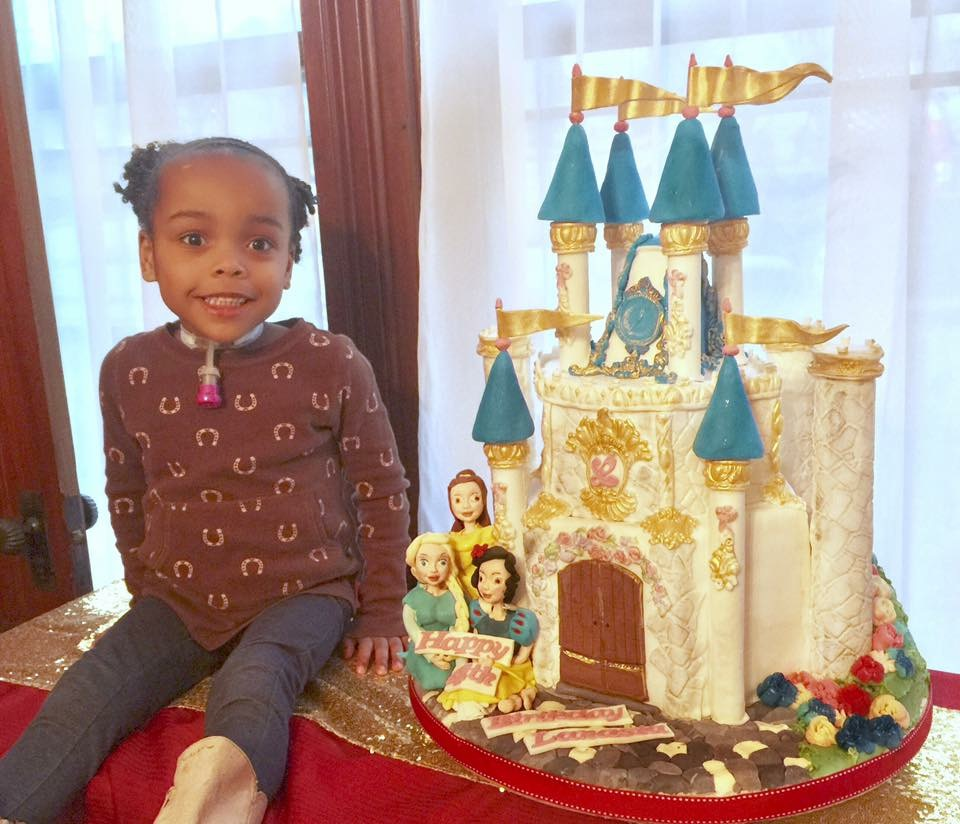 Castle Cake with Disney Princess for Icing Smiles.