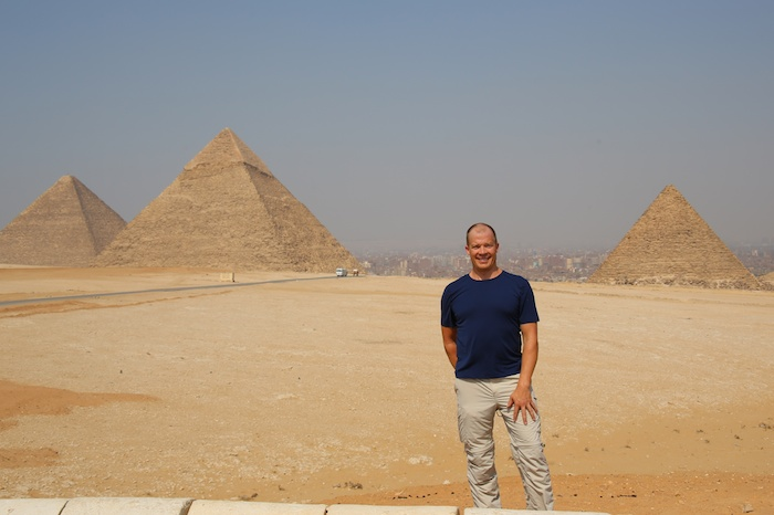 chat cipiti standing in front of a pyramid