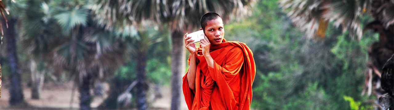 monk dressed in orange in cambodia