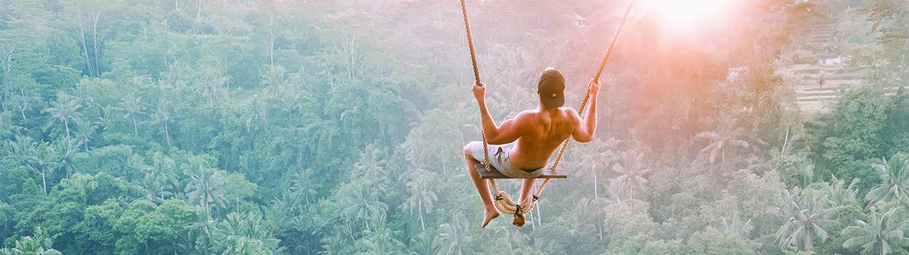 man on a swing in bali