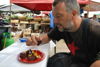 Eating blood sausage, Market day, Villa de Leyva