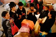 Discussing which shawls (mantas) to select, cholita fashion show, El Alto, La Paz.