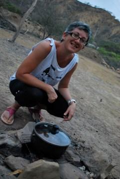 Cooking goat stew over hot coals, Zorritos, Peru