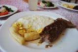 Gorgeous braised beef with cheesy rice and plantains - missions region of Bolivia.