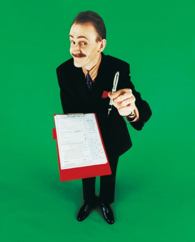 Portrait of a Market Researcher Holding a Fountain Pen and a Questionnaire