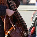 woman loading bag into car boot