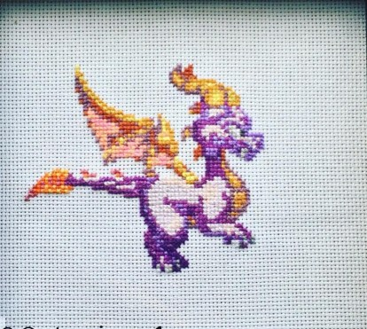 A close up of the Spyro the dragon. Framed in a black frame, this really stands out on the wall.