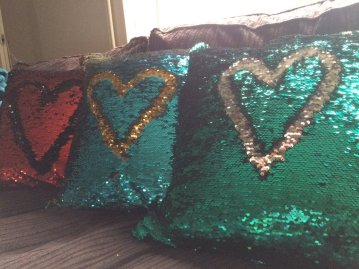 'Mermaid' Sequinned fabric with envelope closing. Removable weighted pad insert to support sensory based therapies.