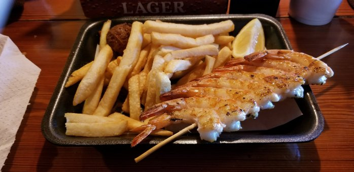 n's Seafood Shack Grilled Shrimp Basket with side of fries and a hushpuppy